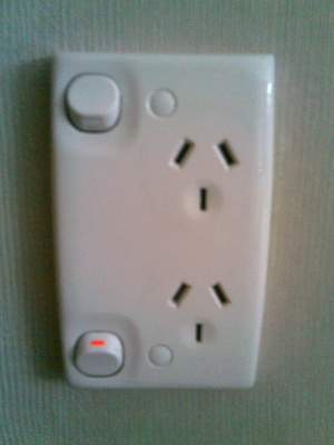 new_zaland_electric_outlet__plug_with_top_plug_off_and_bottom_plug_on_400